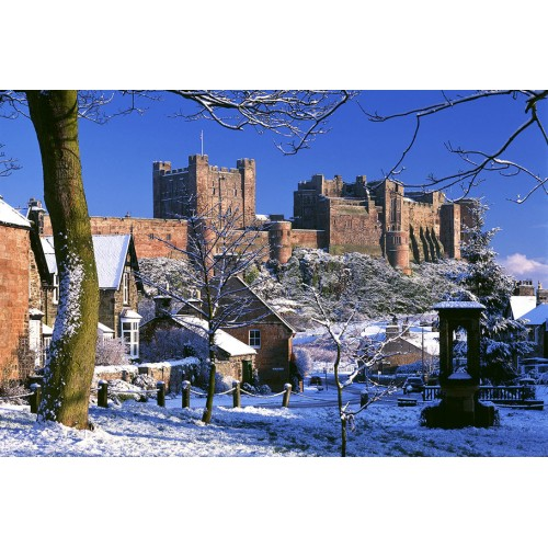 Bamburgh Castle and village in winter