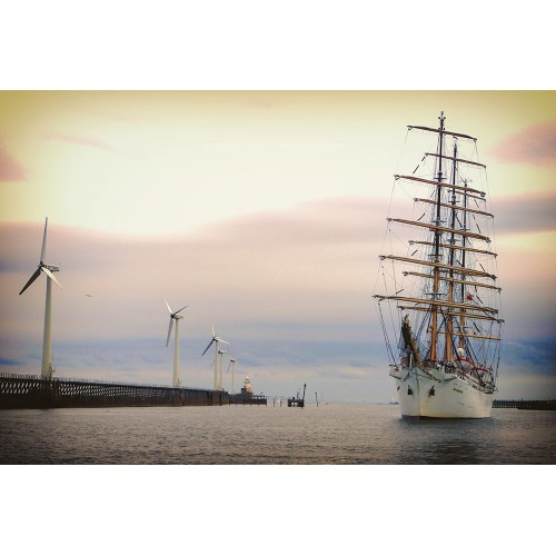 Tall Ship Dar Mlodzeizy with wind turbines on North Blyth Jetty